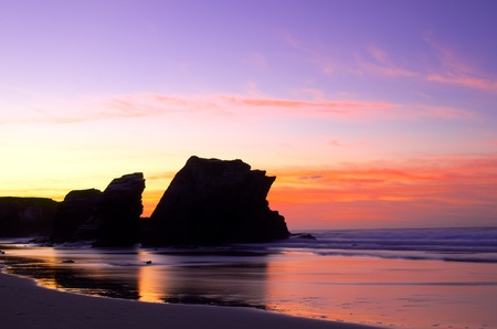 Beautiful sunset on the Atlantic ocean beach of the cathedrals, Spain.