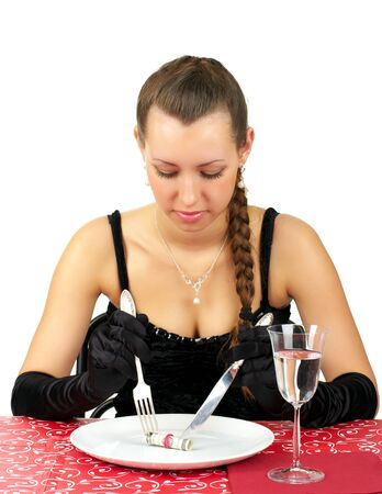 Beautiful woman have a dinner with five dollars on the plate photo