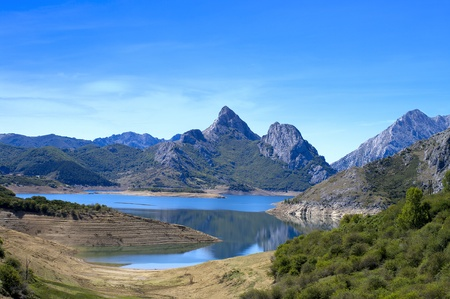 Beautiful mountain landscape with small lake in Spain. Stock Photo