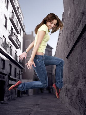 breakdancing: Hip-hop style female dancer in the city