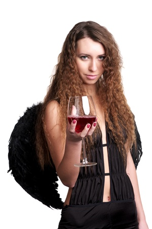 Beautiful female in black angel suit with glass of red wine photo