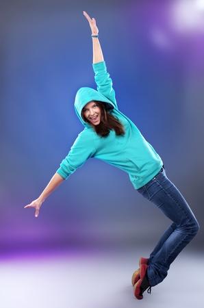 Beautiful hip-hop style female dancer on scene photo