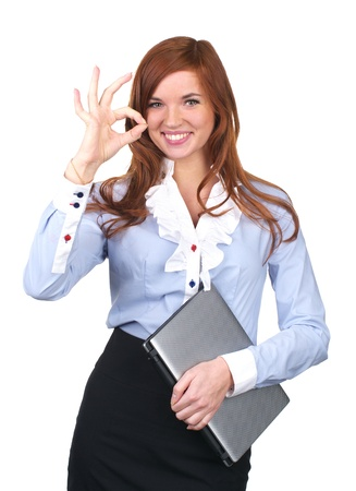 Beautiful businesswoman showing ok sign against white background