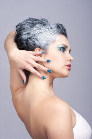 Attractive beauty with creativity hairstyle and winter style make-up photo