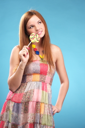 Portrait of beautiful young woman with big lollipop Stock Photo - 22479023