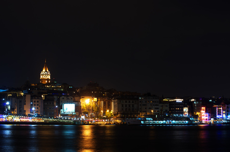 Night view to the Beyoglu district historic architecture and Galata tower Stock Photo