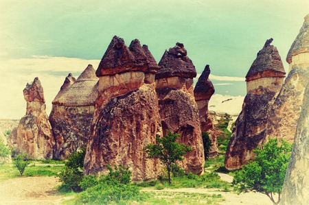 phallic: Beautiful landscape with unique geological formations in the Cappadocia, Turkey. Retro style photo.