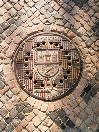 Traditional manhole cover for street hatchway in Prague, Czech republic