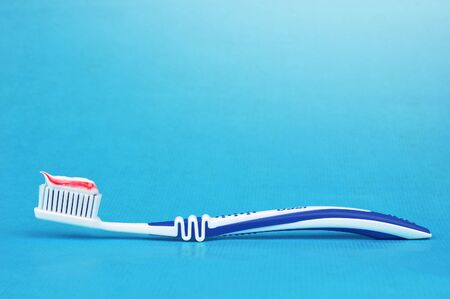 regular people: Toothbrush with toothpaste on a blue background