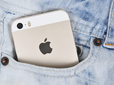 5s: Chlumcany CZECH REPUBLIC MARCH 10 2015: The Gold iPhone 5s in a denim pocket