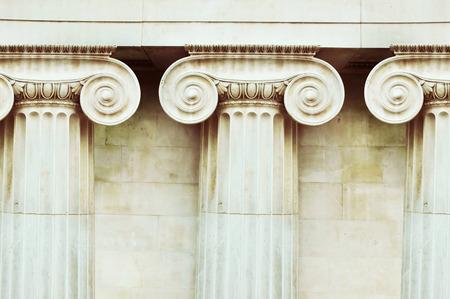 doric: Three antique columns in Doric style closeup