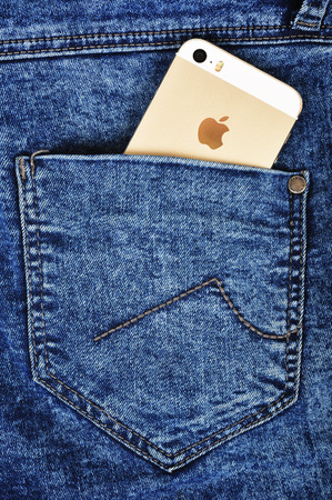 5s: CHLUMCANY, CZECH REPUBLIC, MARCH 10. 2015: Apple iPhone 5s in a denim back pocket