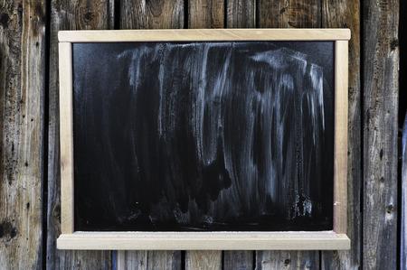 edu: Dirty chalkboard on a wooden wall Stock Photo