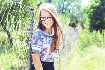 caucasion: Summer portrait of a beautiful young girl with glasses