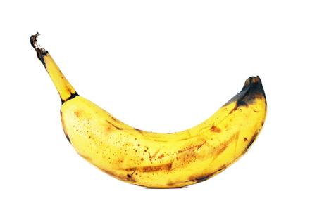 putrefy: Rotten banana isolated on white
