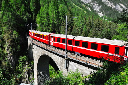 viaduct: Red swiss train on viaduct, Switzerland