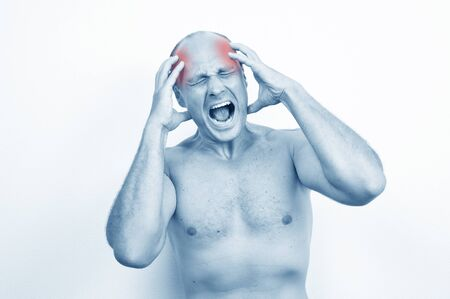 terrible: Man suffering a terrible headache