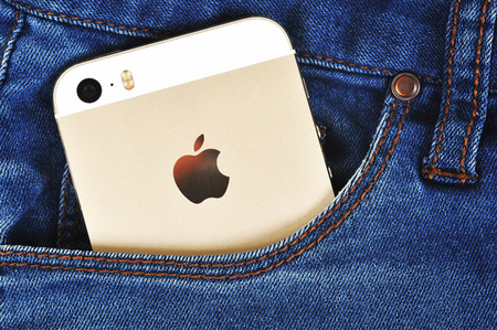 5s: CHLUMCANY, CZECH REPUBLIC, MARCH 10, 2015: Apple iPhone 5s in a denim pocket
