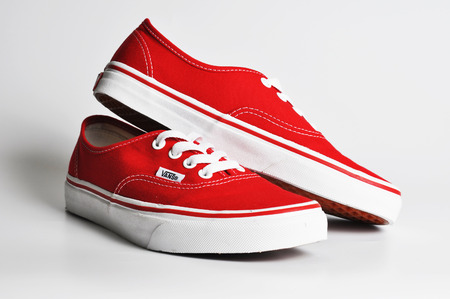 illustrative material: CHLUMCANY, CZECH REPUBLIC, MAY 3, 2015: Vans Authentic Red sneakers on a white background