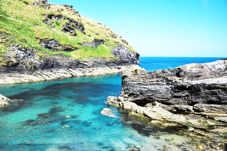 great bay: Merlins Cave - Tintagel bay in North Cornwall coast, England, Great Britain, Europe Stock Photo