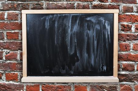 edu: Dirty chalkboard on a brick wall