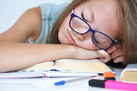 fell: Girl fell asleep on her homework because she was bored