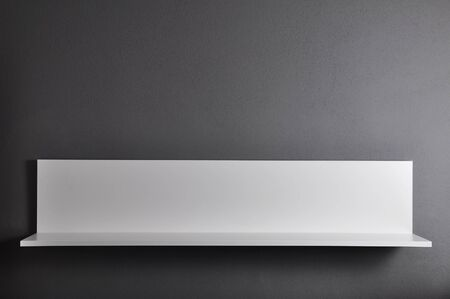 shelf: White shelf on gray wall for product display