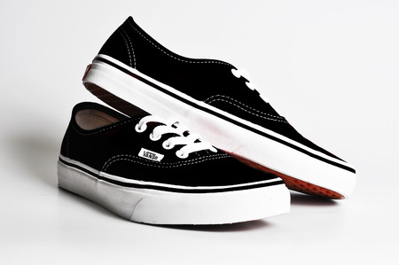 CHLUMCANY, CZECH REPUBLIC, MAY 3, 2015: Vans Authentic Black sneakers on a white background