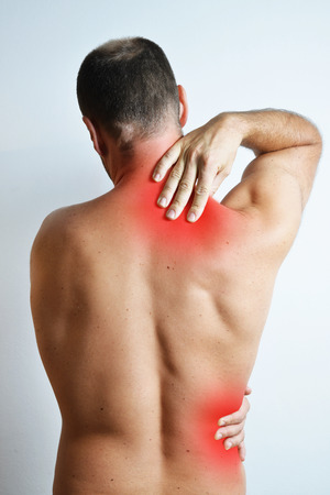back ache: Concept of a pain in back shoulder of adult man, isolated on the white background