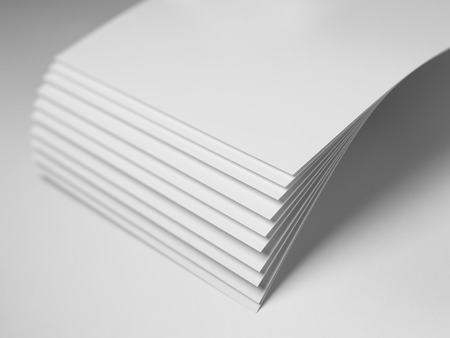 Close up shot of plain white paper with shallow depth of field and focus on the corners and fanned out area Stock Photo