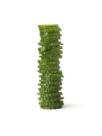 shot of a sliced, fresh cucumber stacked upright on a pure white background Stock Photo