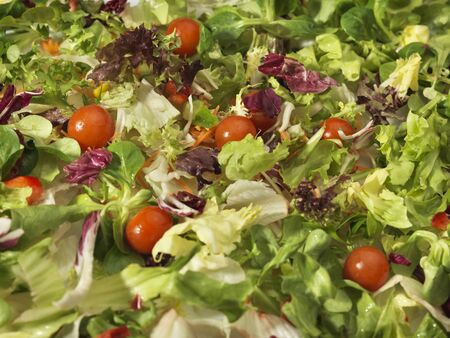 Close up, full frame, shot of fresh salad with a wide variety of vegetables background Stock Photo