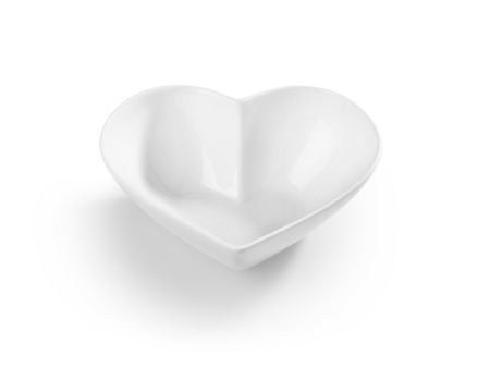 Shot of an empty heart shaped cereal bowl cut out and isolated on white.