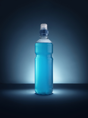 Shot of a blue energy drink on a vignetted background