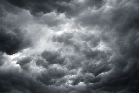 storm clouds: shot of dark and ominous storm clouds showing bad weather ahead