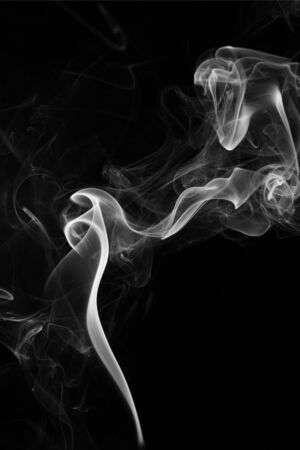 smoke rising on a black background