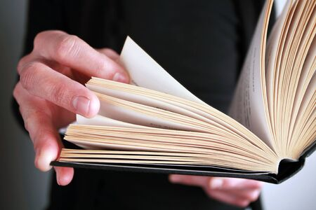 close up pic of person reading a book