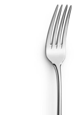 silver reflection: close up of a fork on a white background with copy space