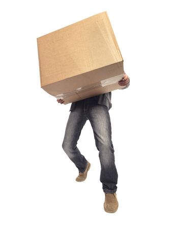 shot of man carrying large box and struggling with the weight of it while moving house
