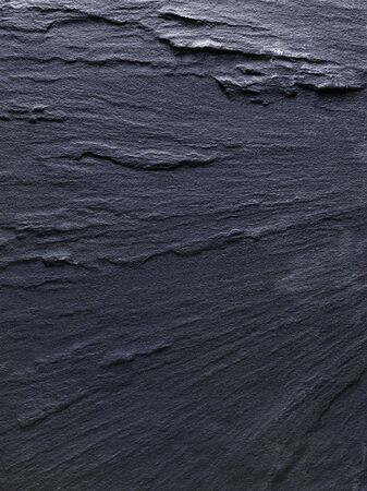 surface level: shot of slate background with directional lighting to emphasize texture and shape Stock Photo