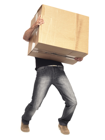 man carrying box: Man carrying heavy box isolated on white with clipping path Stock Photo