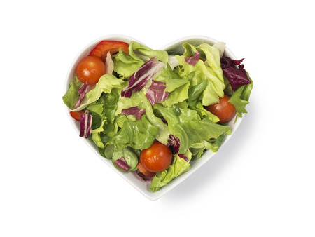 salad bowl: Fresh salad in heart shaped bowl isolated on white with clipping path