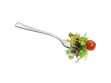 Close-up of salad on a fork, isolated on a white background with clipping Path