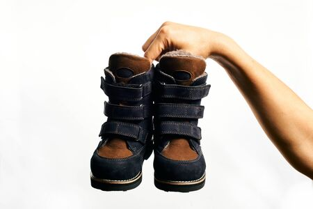 Orthopedic footwear. Winter footwear. Orthopedic baby shoes. Stock Photo