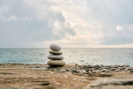 Balance, peace of mind, different sizes stones form a pyramid. Stock Photo