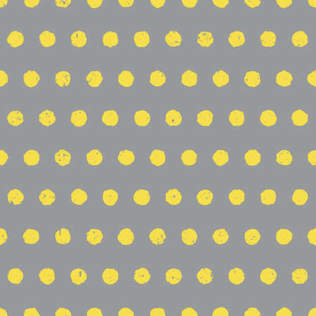 Gray and yellow textured polka dot background in colors of the year 2021. Cute seamless pattern with yellow circles on gray background. Hand drawn doodle style. Vector illustration.