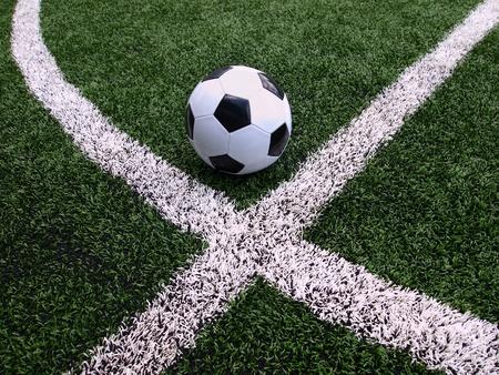 football match lawns: Soccer ball on green field   Stock Photo