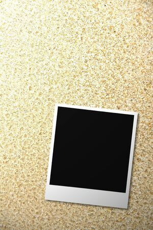 confines: Aged photo frame on sand background