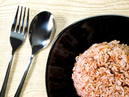 brown rice: Brown rice with a spoon and fork