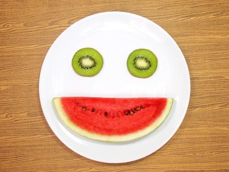 Smile watermelon and kiwi served on white plate  Standard-Bild